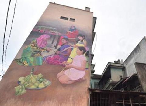 大馬一大型壁畫完工:四族孩子裹馬來飯團展和諧